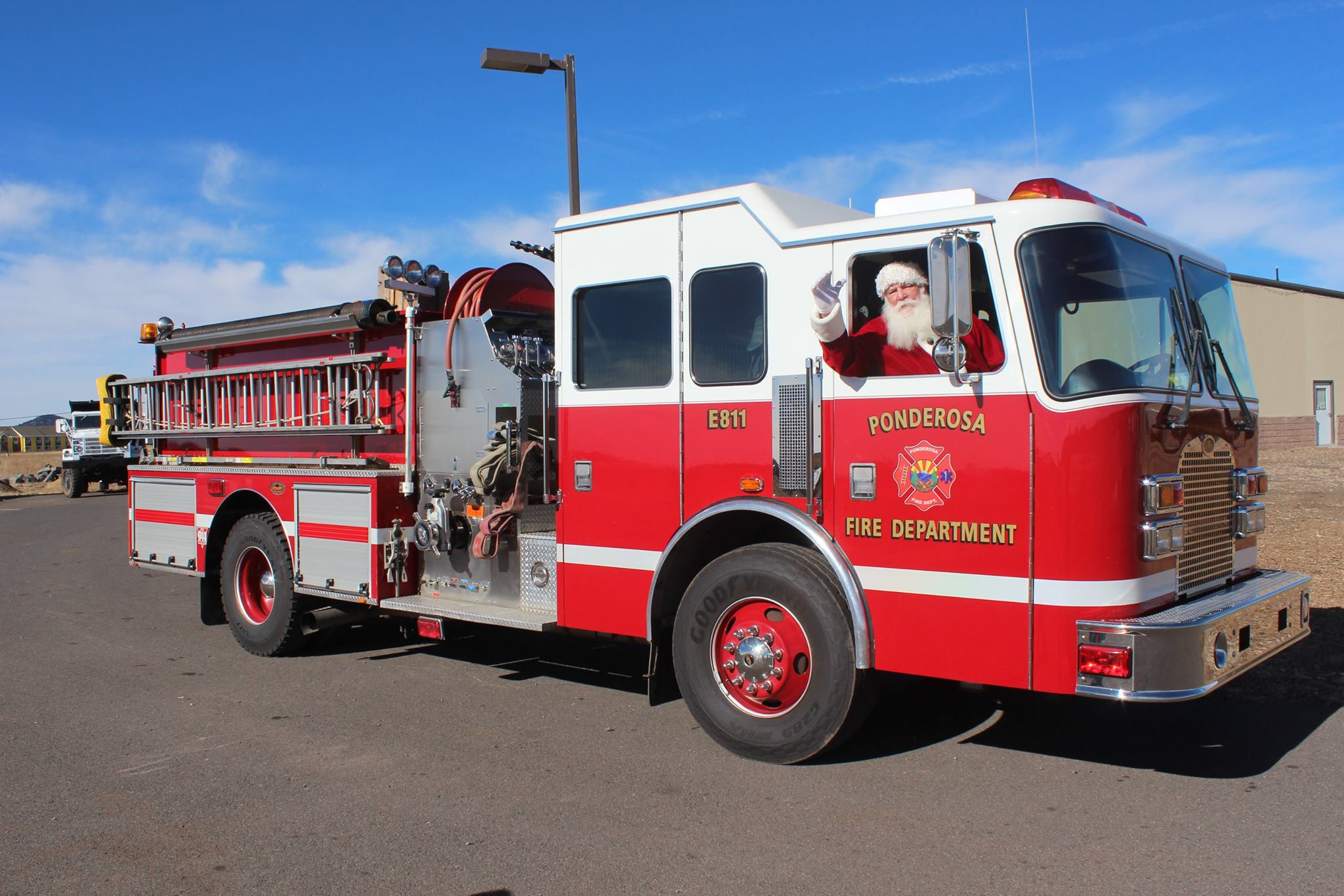 Santa taking a picture in the fire truck