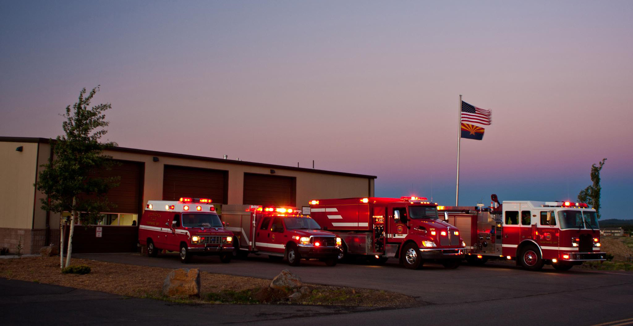 Flight of trucks outside station 82
